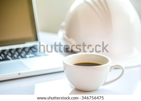 Wood desk with office supplies and cup of coffee (selective focus)