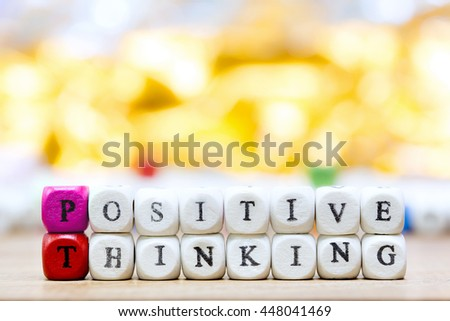 Wood dice with Words Positive Thinking motivational slogan on wooden table