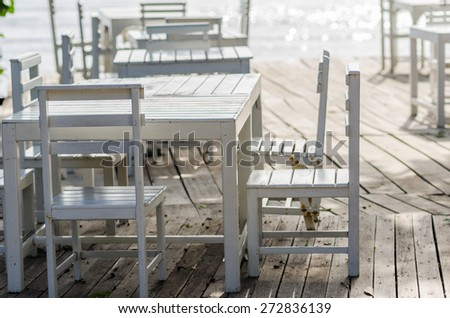 Wood dock White chair and table in Koh Samet Thailand - stock photo