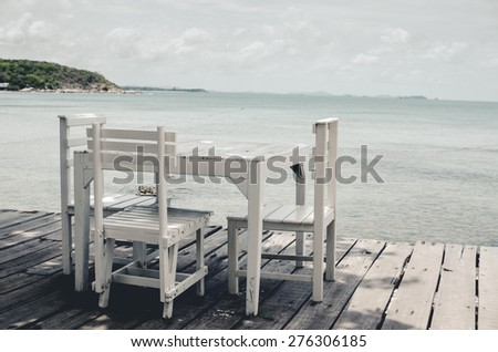 Wood dock White chair and table in Koh Samet Thailand vintage - stock photo
