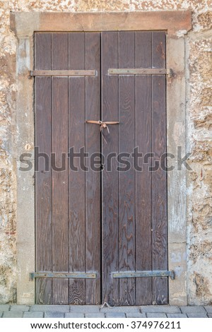 Wood door with fabric bow on old wall by sunset time in Tel Aviv, Israel.