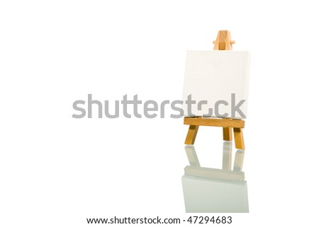 wood easel and white canvas over white background