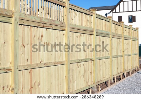 Wood fence in a housing subdivision. - stock photo