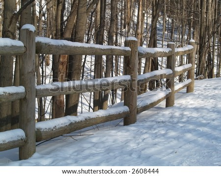 wood fence snow forest winter - stock photo