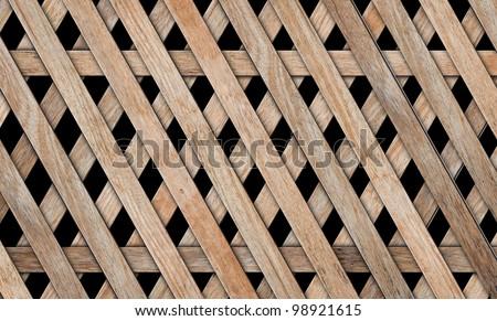 wood fence weave on black background - stock photo