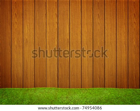 Wood fence with green grass - stock photo