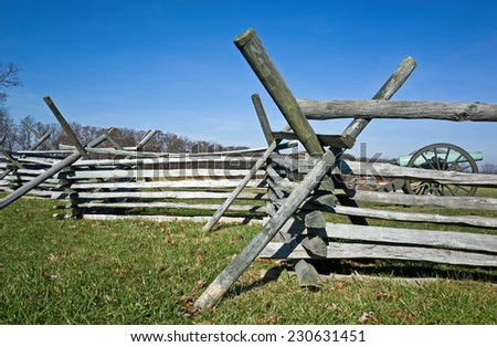 Wood fencing in a Civil War battlefield in the afternoon sun of a warm autumn day. - stock photo