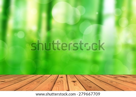 Wood floor and abstract green tree background bokeh - stock photo