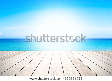 wood floor background blurred ocean beach abstract style.Light center of the image - stock photo