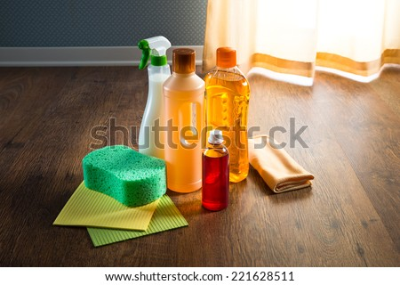 Wood floor cleaner products on parquet with sponges and microfiber cloth. - stock photo