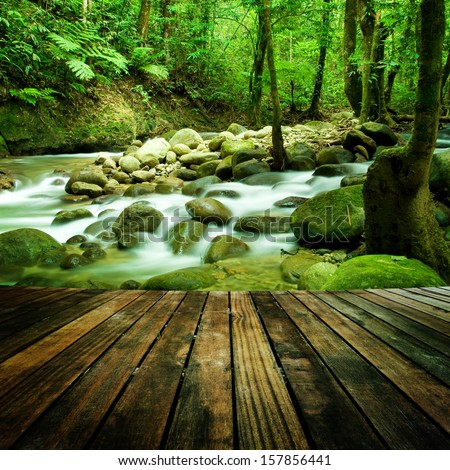 Wood floor perspective and natural mountain waterfall - stock photo