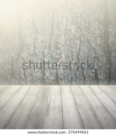 Wood floor texture with dart tree background and light of sun