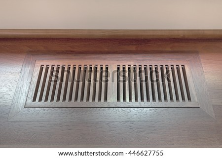 Wood Floor Vent Cover for home heating and cooling system - stock photo