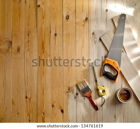 wood floor with a brush, paint and tools - stock photo