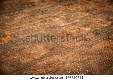 Wood floor with brown stains.