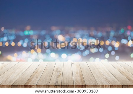 Wood floor with city night scene and bokeh far away. - stock photo