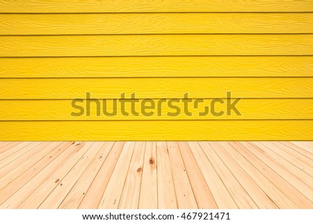 Wood floors and wood wall yellow.