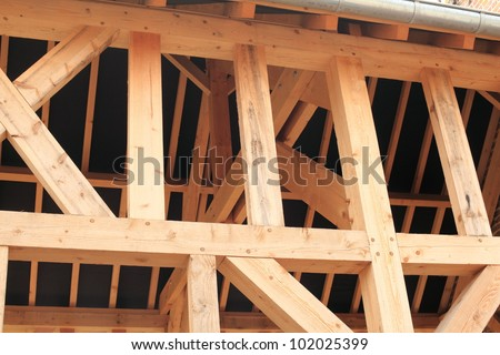 wood frame of a house under construction - stock photo