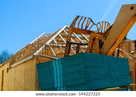 Wood frame of house under construction, new building house