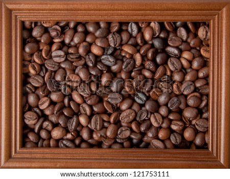 wood frame on the background of coffee beans