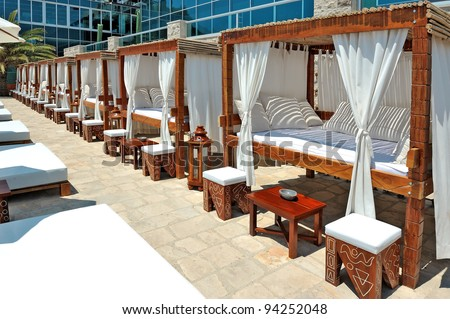 Wood framed  canopy offer relaxation in the touristic resort - stock photo