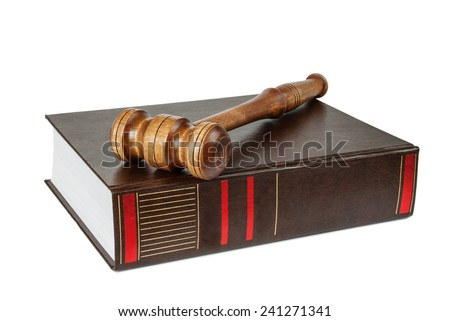 Wood gavel and soundblock on on a thick book isolated on white - stock photo