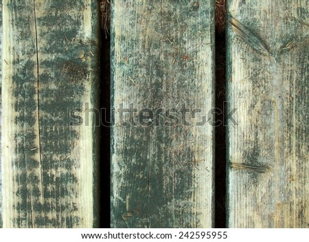 Wood grain from planks on deck or patio with green paint - stock photo