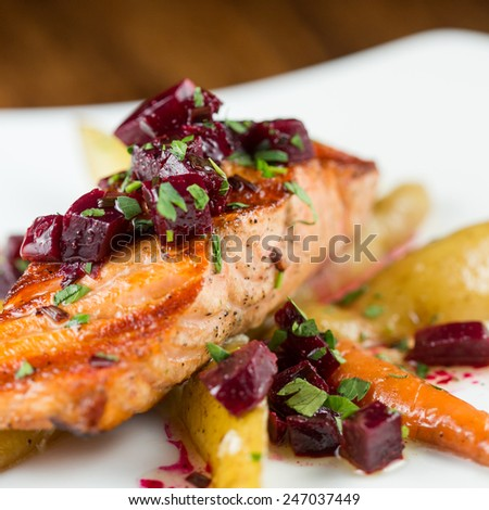 Wood Grilled Organic Salmon with fingerling potatoes, baby carrots and roasted baby beet vinaigrette