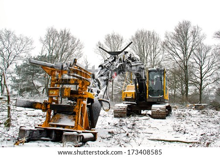 Wood harvester in snow