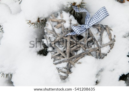 Wood heart in the snow, christmas decoration