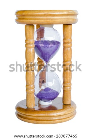 Wood hour-glass with violet sand. Isolated on white background, save clipping path.