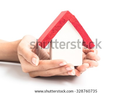 Wood House in women hand on white background. Concept  real estate, ecology, freedom and lifestyle issues. - stock photo