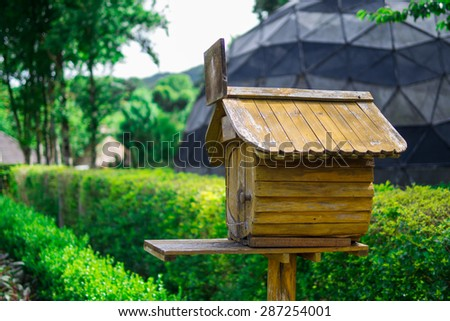 Wood house postbox - stock photo