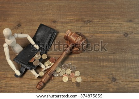 Wood Humane Figurine, Empty Black leather Male Wallet, Different British Coins And Judges Gavel on Rough Brown Wood Table Background, Top View, Copy Space