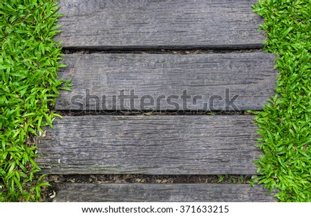 wood in the grass, making a way