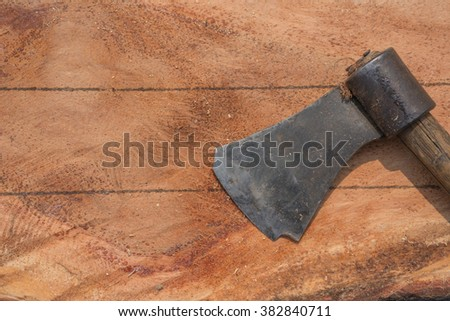 Wood is cut with an ax laid on it