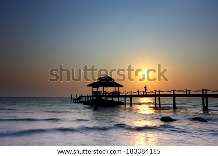 Wood jetty connect with pavilion sunset on Ao noi beach,Koh Kood at Trat,Thailand