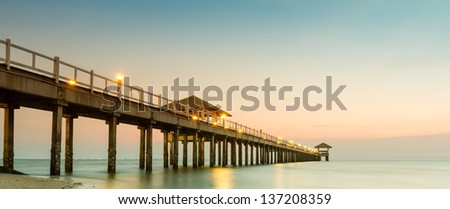 Wood jetty on the Beach and tropical sea. - stock photo