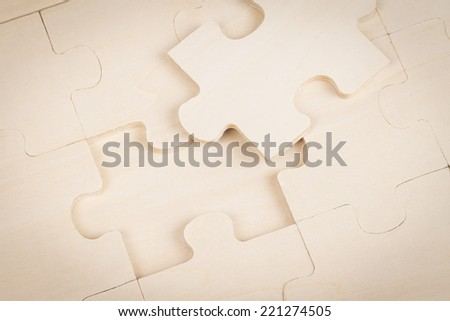 Wood jigsaw missing - stock photo