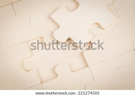 Wood jigsaw missing - stock photo