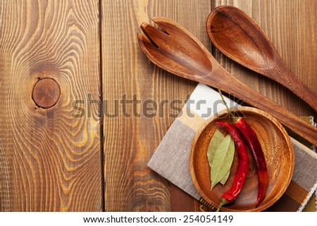 Wood kitchen utensils and spices over wooden table background with copy space - stock photo