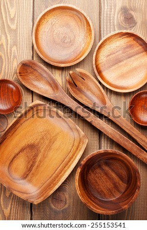 Wood kitchen utensils over wooden table background - stock photo