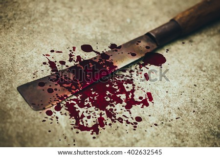 wood knife with grungy blood mark, crime murder and violation concept.