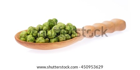wood ladle of Green beans snacks isolated on white background