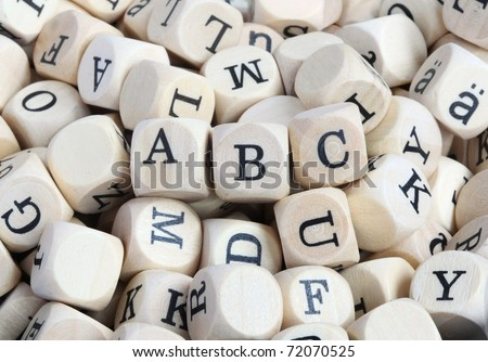 "Wood letter blocks with focus on ""ABC"" (Designer can blur other letters, if desired)"