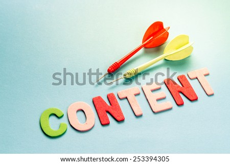 Wood letters as Content word with darts - stock photo