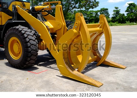 Wood log grapple, wheel loader attachment