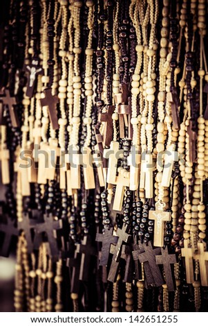 Wood made crosses for sale on colorful background