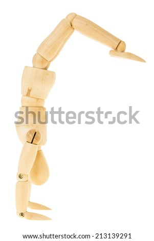 wood manikin in hand standing pose with leg reverse on white background - stock photo