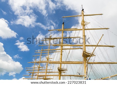 Wood masts of an old clipper ship against a nice sky - stock photo